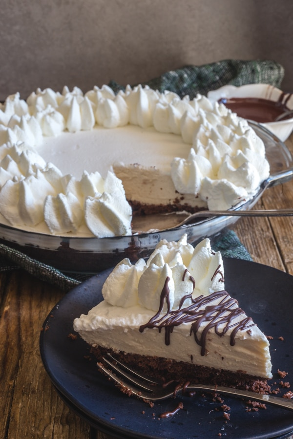 mousse pie with a slice on a black plate