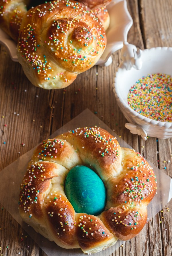 2 individual easter bread on a wooden board