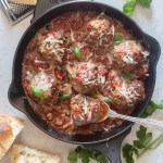 baked meatballs in a black skillet