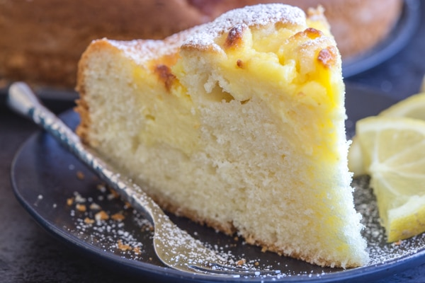 up close slice of Italian pastry cream filled lemon cake.