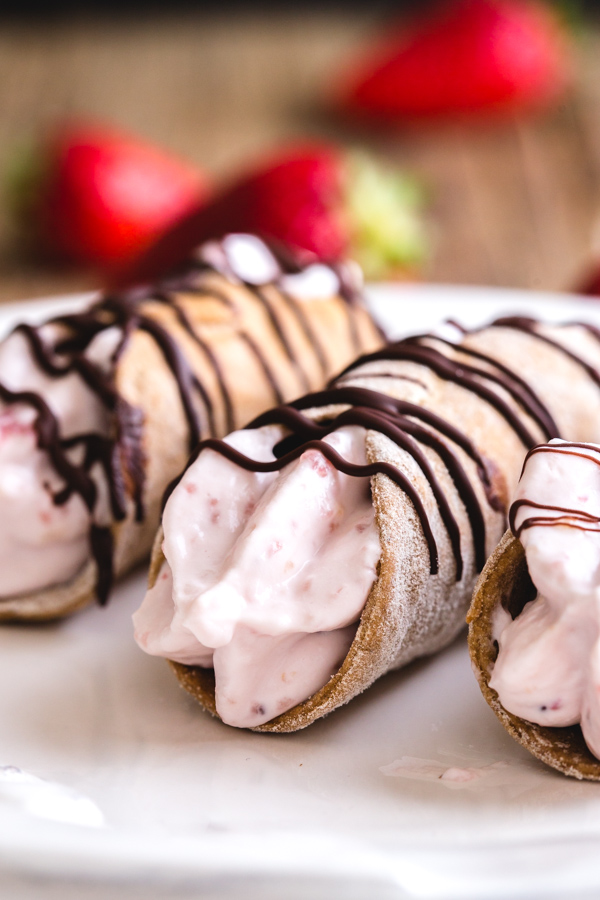 strawberry cannoli on a white plate