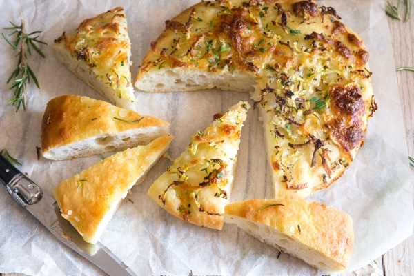 potato focaccia bread on a white paper cut into pieces