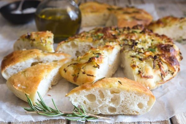 slices of potato focaccia on white parchment paper