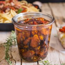 roasted tomatoes under oil in a glass jar