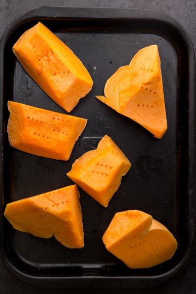 chunks of pumpkin on a cookie sheet