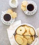 Italian butter cookies in a cookie bowl with 2 cups of expresso
