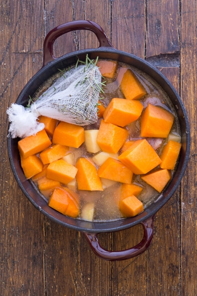 ingredients for pumpkin stew in the pot to cook