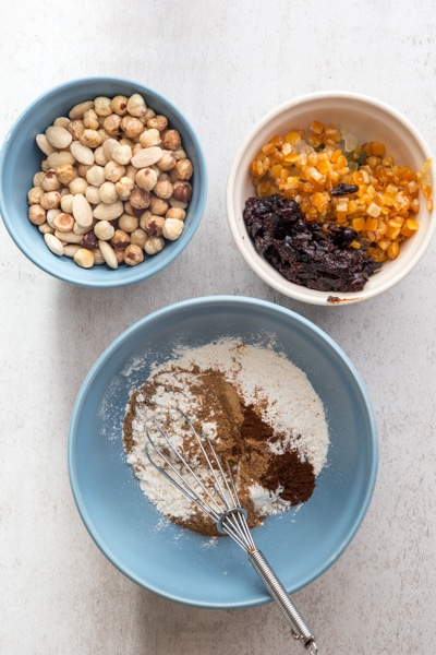mixing the flour and spices in a blue bowl,