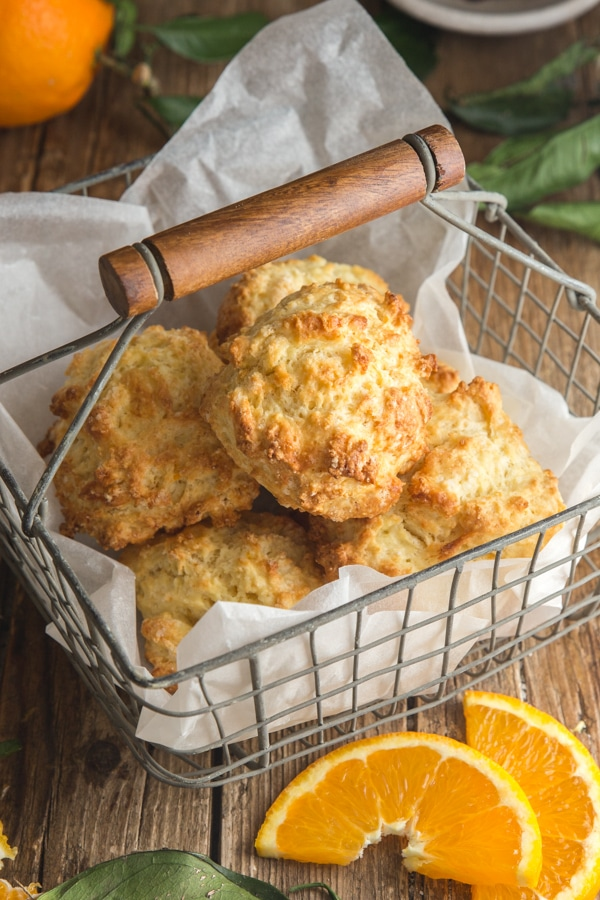 drop biscuits in a wire basket with slices of oranges