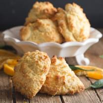 drop biscuits on a white plate and 2 on a wooden board