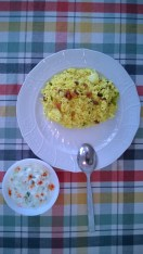 Lemon rice served with a cucumber raita