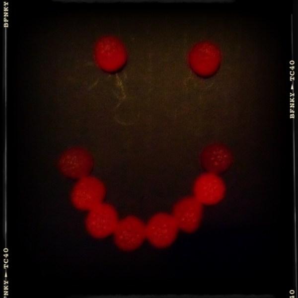 Smile Again: Day 45 Raspberry Gummy Lollies on Black Fabric