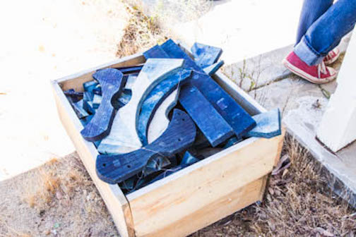 wood clamps used to bind fabric and submerge to indigo dye