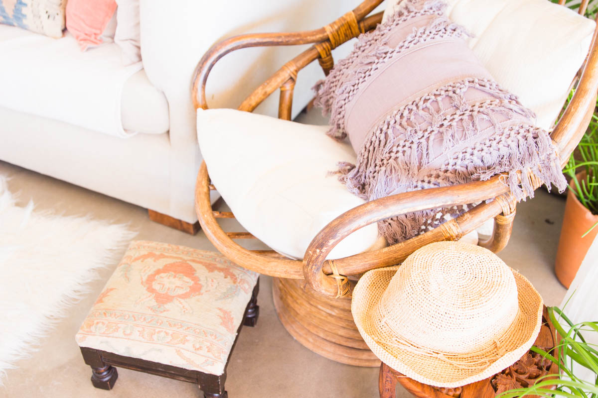 rattan boho chic chair with fringe pillow foot stool