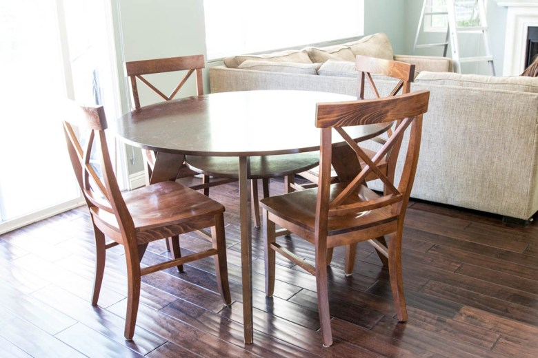 round wood brown table with pottery barn X back chairs