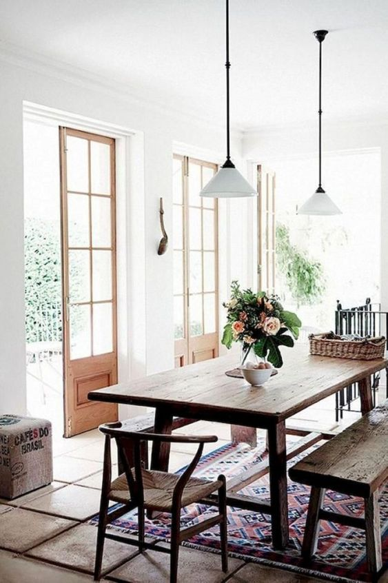 modern rustic French doors vintage rug dining table hanging pendants