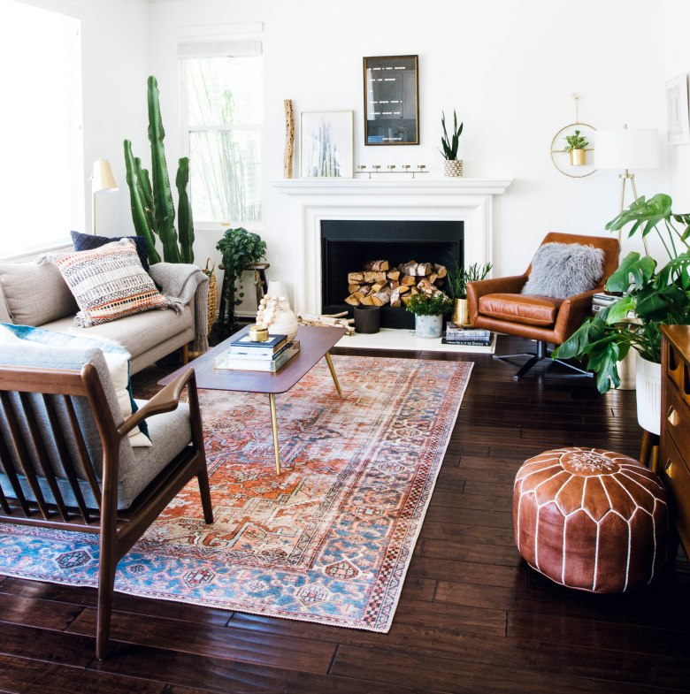 west elm leather chair, joy bird chair, loloi rug mid century family room fireplace mantel