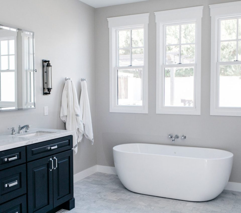 free standing tub navy bathroom cabinets grey paint sconce
