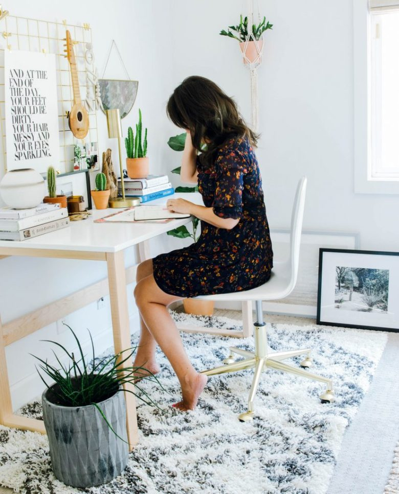 Designer Anita Yokota Sitting at mid-century scandanavian desk