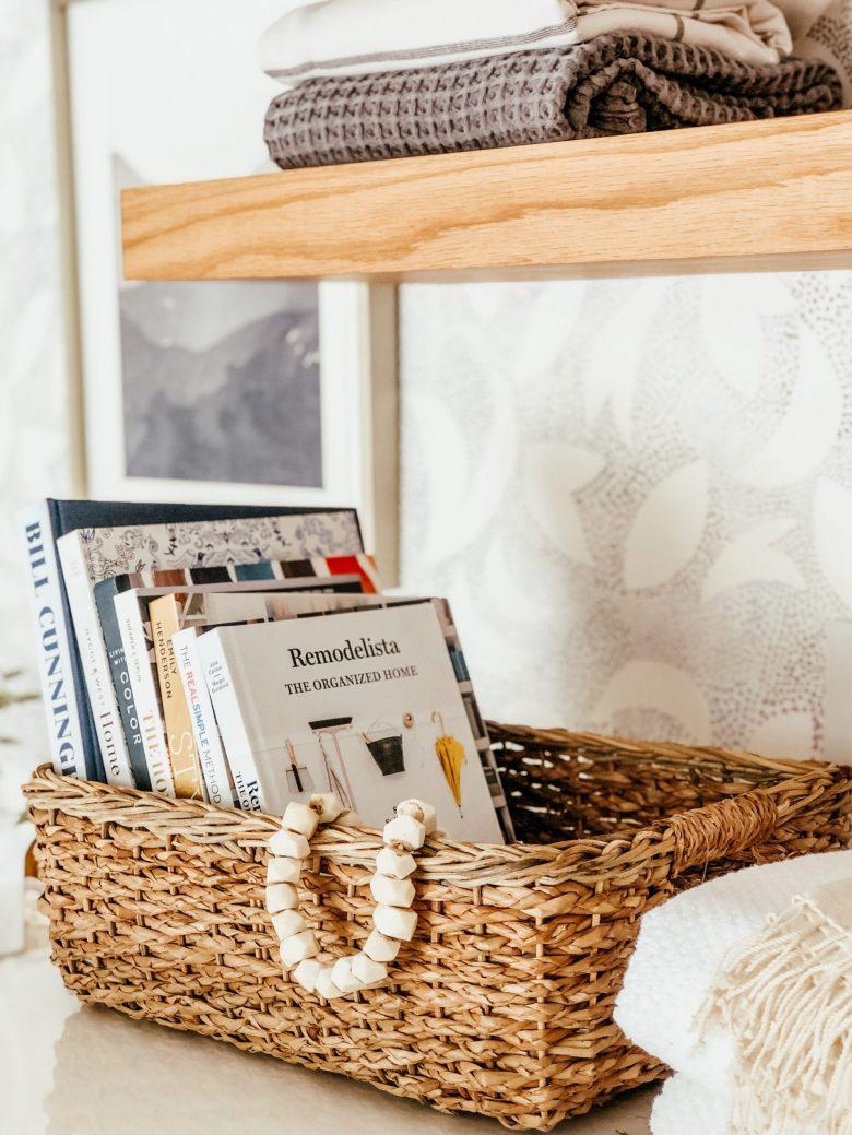 open shelving baskets organizing books parachute towels minted art