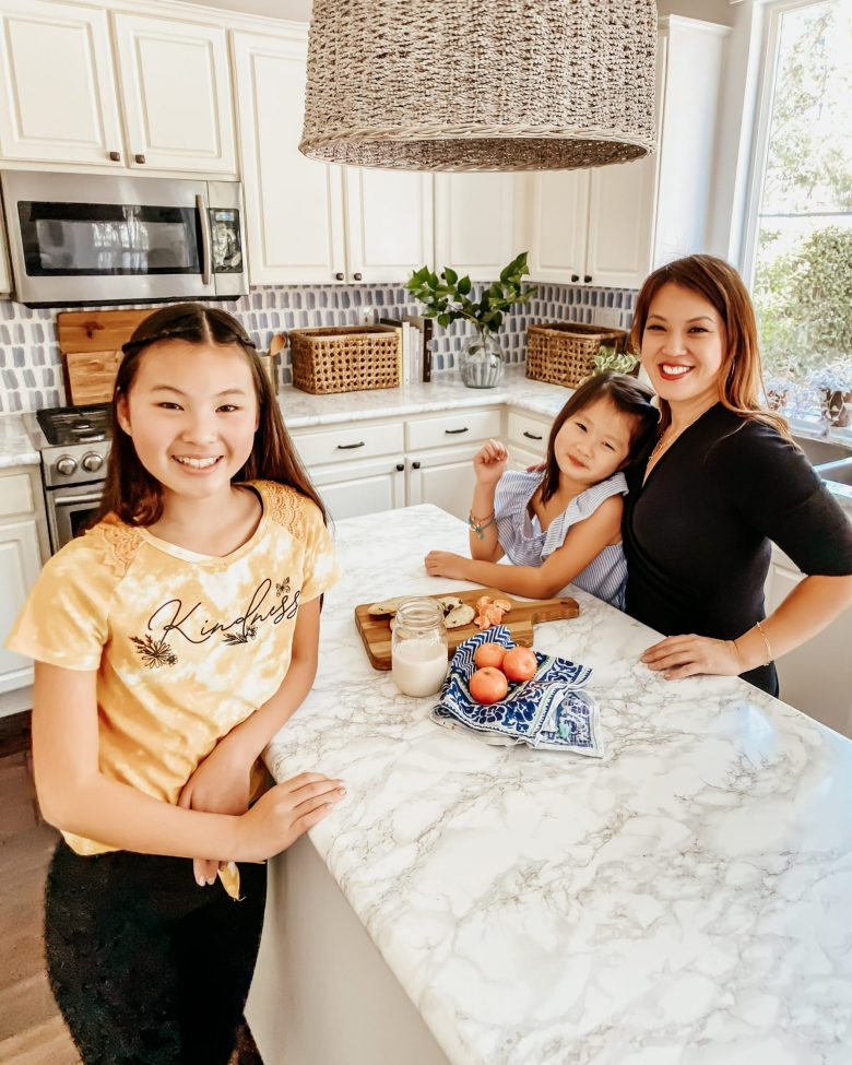 Natalie & Emily with Mom at the Kitchen Island