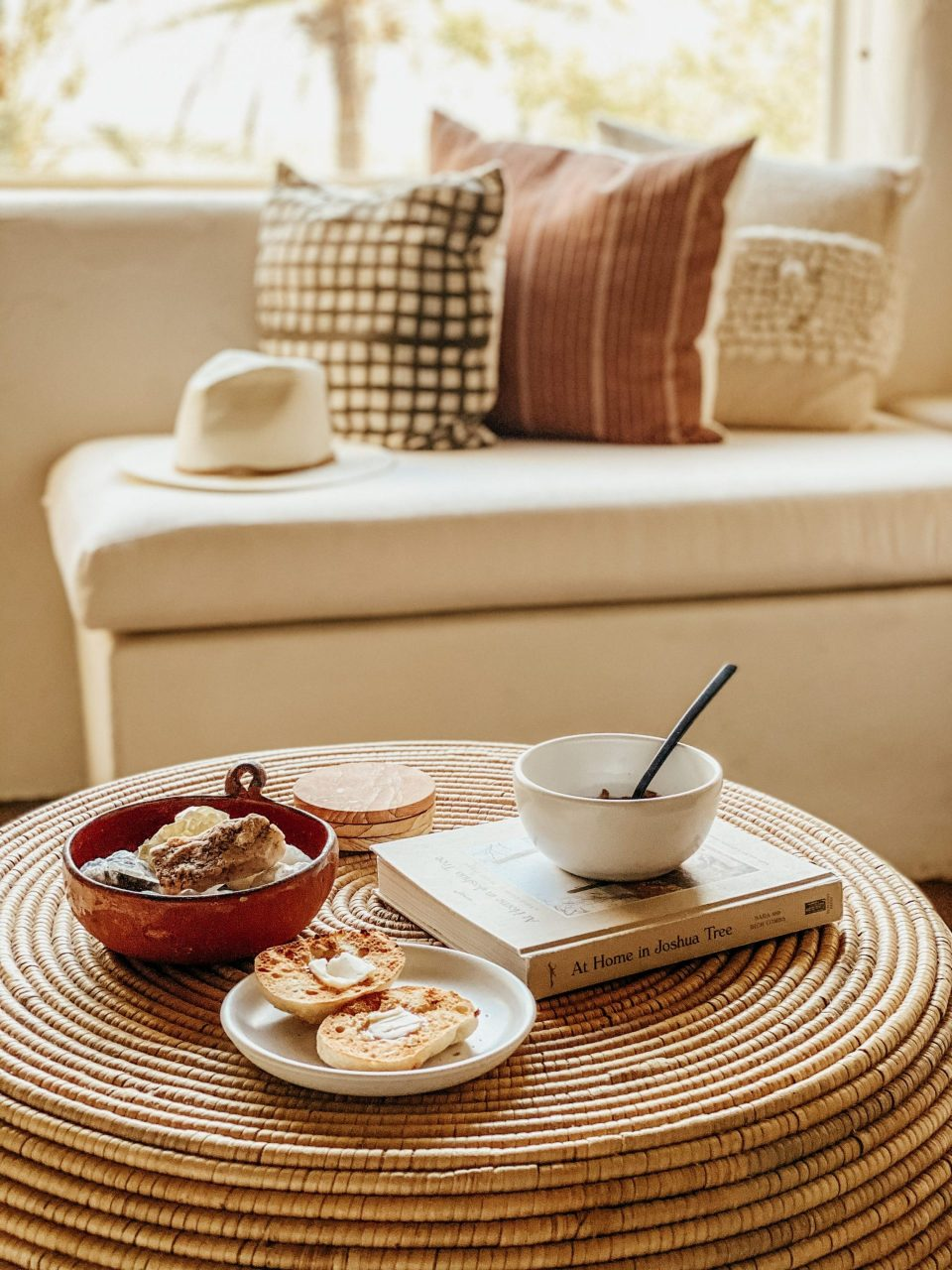 healthy, wholesome breakfast laid out on a wicker ottoman