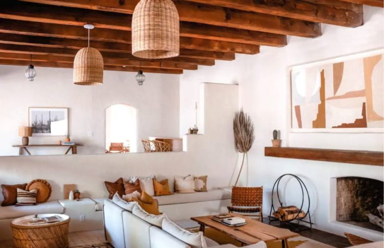 the light living room in the Ocotillo Suite, with wood beams and woven accents