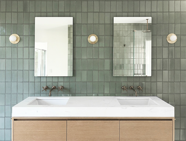 Green tiled wall behind the Jack & Jill sink