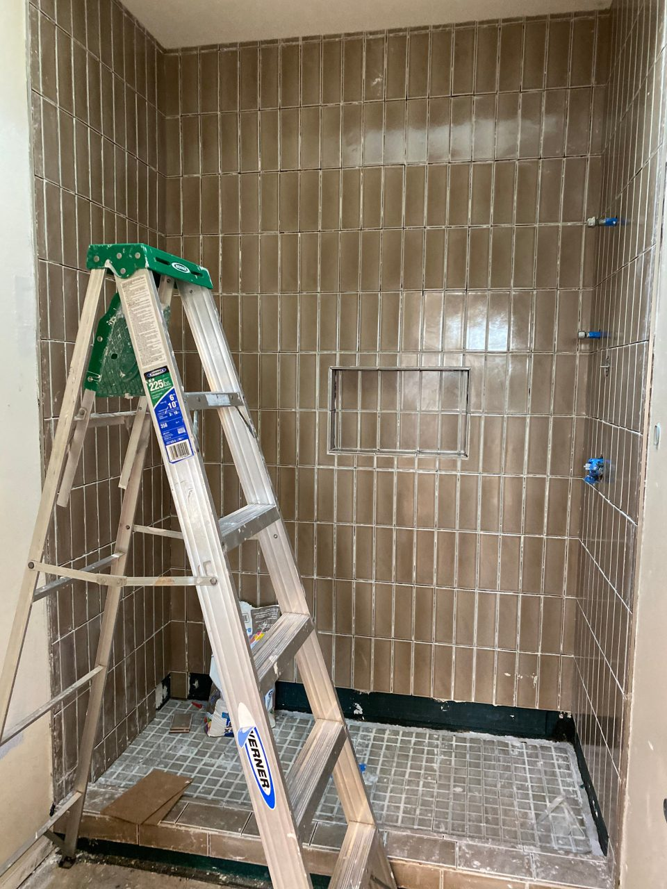 The new fireclay tile in our shower is looking good, but we're not done yet!