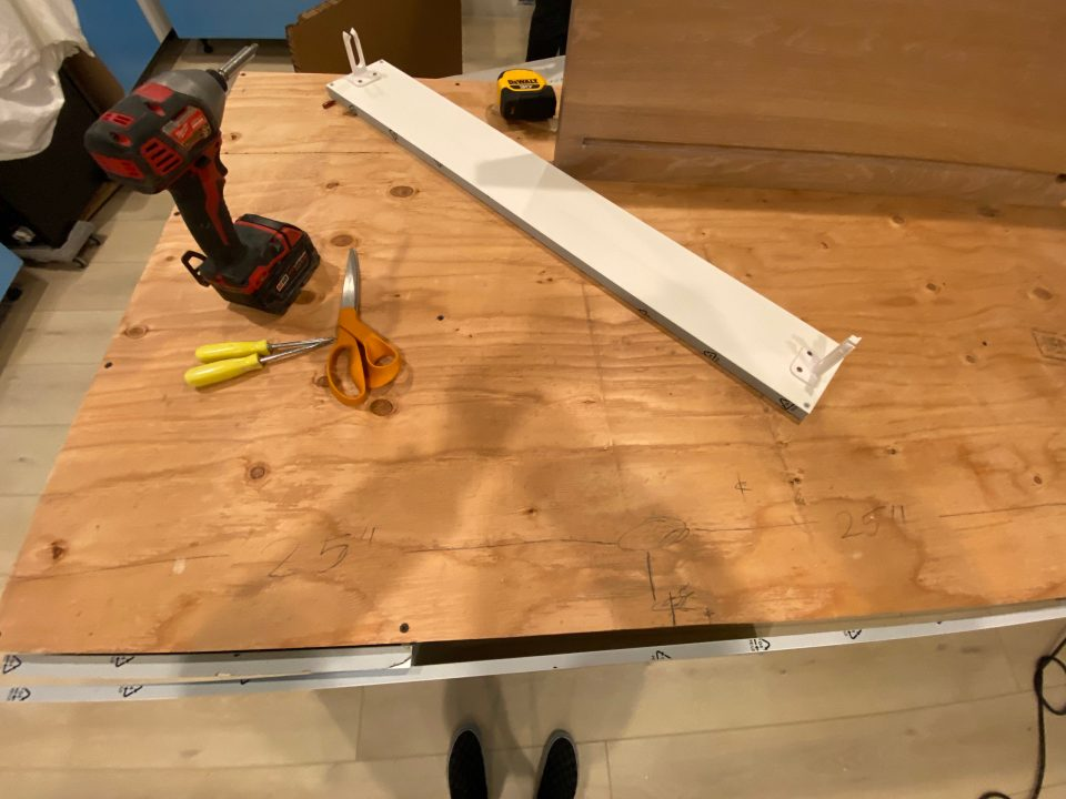 The wooden base for the countertops with measurements penciled all over