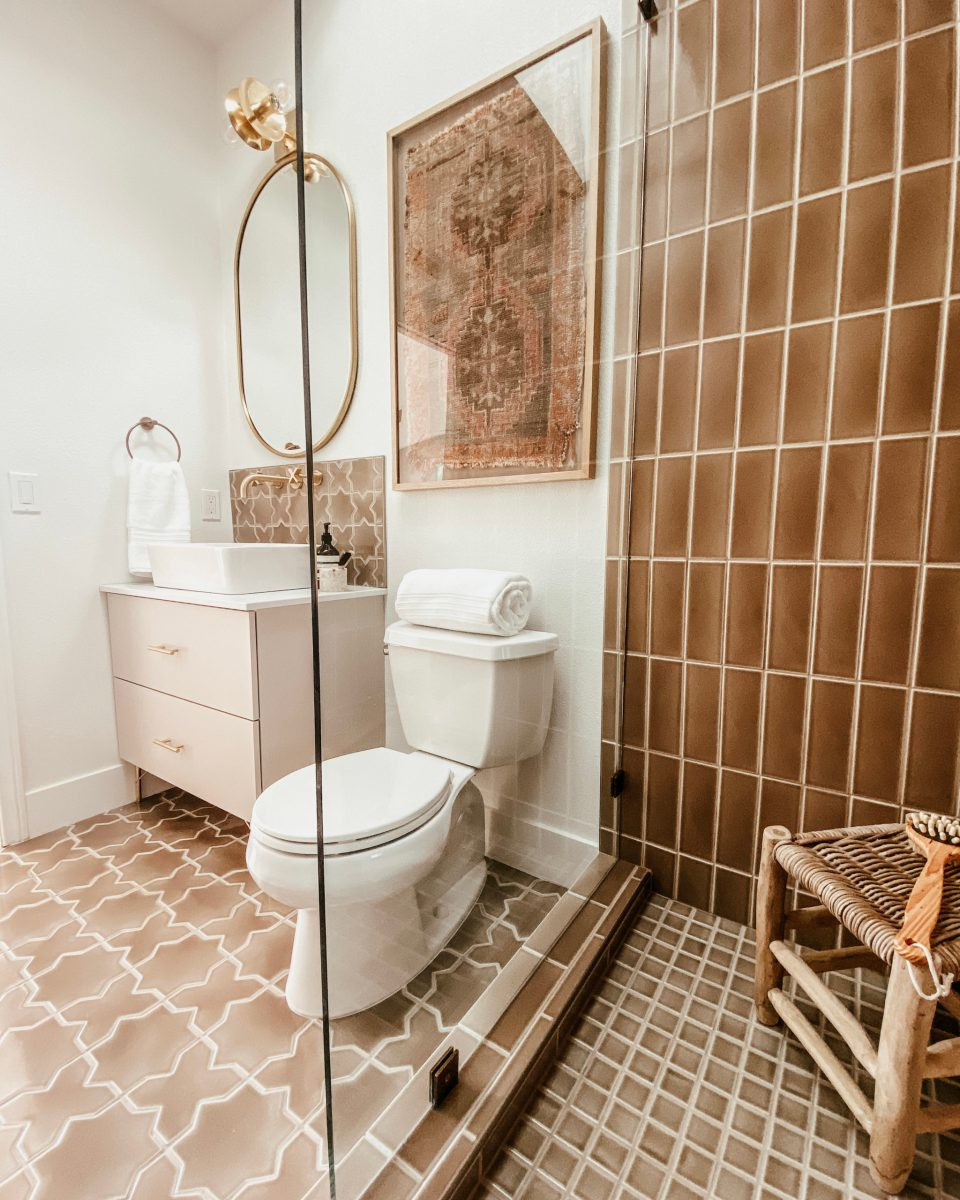 The desert bathroom seen from the shower. The fireclay tile is perfectly accented by the new cabinet and brass fixtures