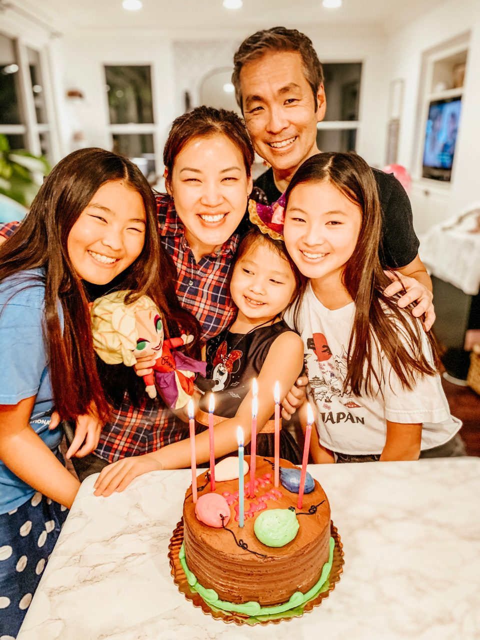 A sweet family moment, all five Yokotas gathered around a cake for Natalie's birthday