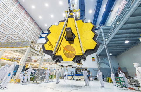 The James Webb Space Telescope, seen here inside a clean room at NASA's Goddard Space Flight Center, has been designed to capture light from the first galaxies that formed in the early universe.