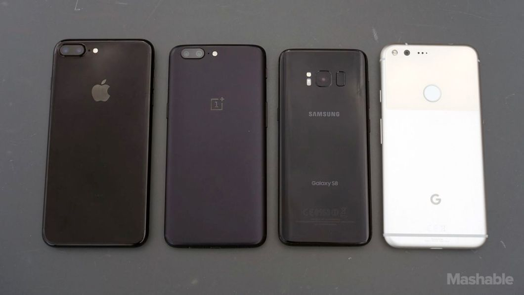 Left to right: The backs of the iPhone 7 Plus, OnePlus 5, Galaxy S8, Pixel XL