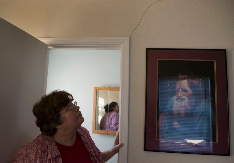 Oklahoma resident Lisa Griggs believes cracks in her home have been caused by Oklahoma's manmade earthquakes.