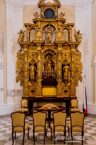Altar and four chairs at the chappel.
