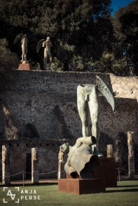 Modern statues as part of old Pompeii