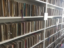 Close up of of two bookshelves showing the rows of countless sketchbooks