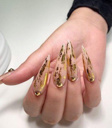 Shiny gold nail design