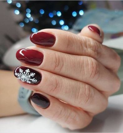 Red and white snowflake nails