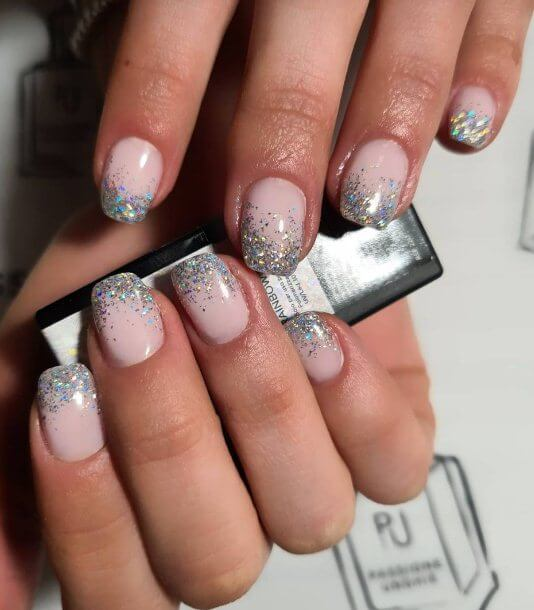 9. French Ombre Nails with Silver Sparkle