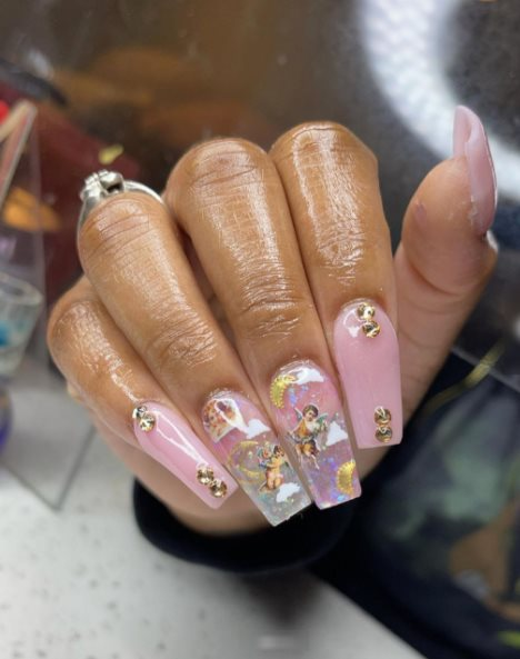 Marble nails with angel stickers