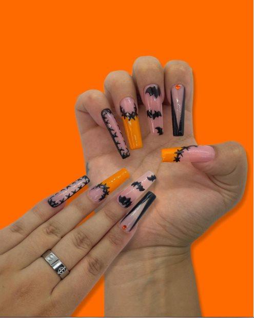 Halloween pink bat nails