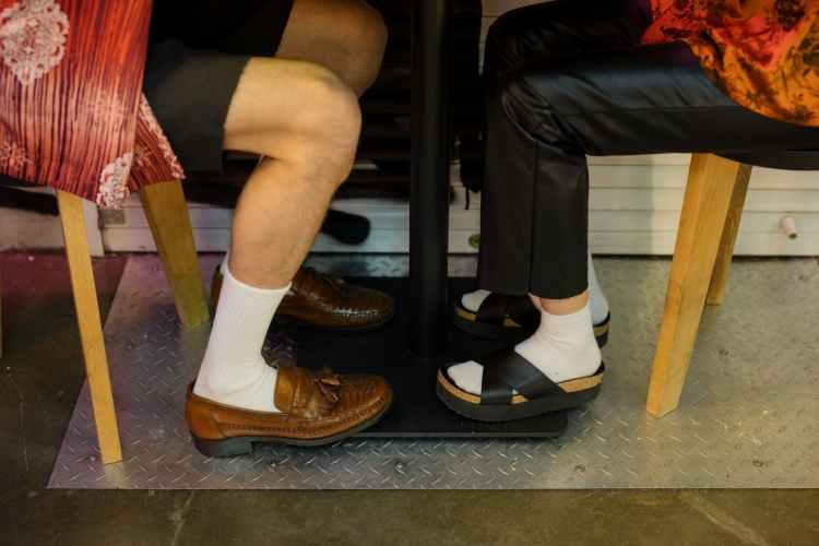 people sitting wearing white socks