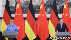 Merkel In China To Press For Dialogue On Human Rights