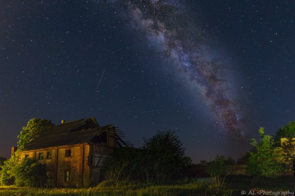 Milky way over an old farmhouse