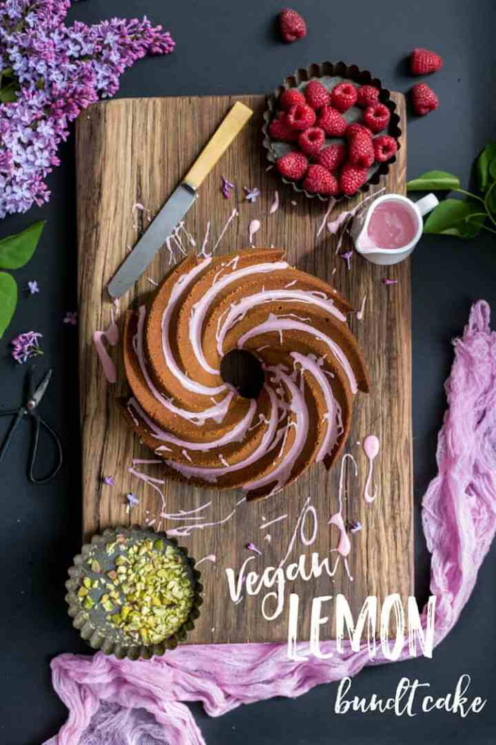 Vegan Lemon bundt cake with pink icing and crushed pistachio nuts | via @annabanana.co