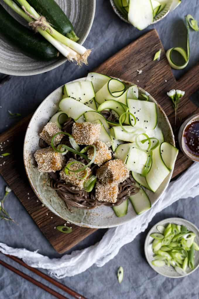 Sticky Tofu coated in sesame seeds, served with soba noodles and zucchini   via @annabanana.co