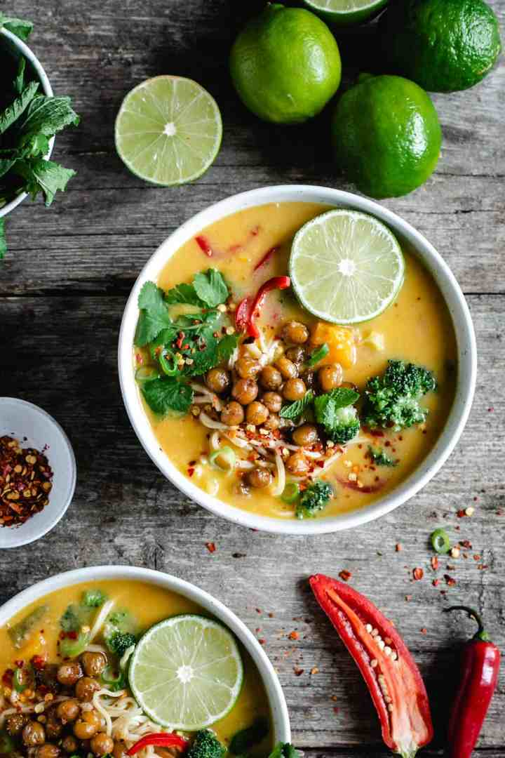 Overhead shot of a small bowl of Thai style pumpkin laksa with crunchy chickpeas and broccoli
