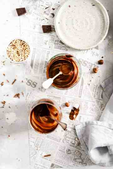 overhead shot of two empty glasses with remains of vegan chocolate pudding